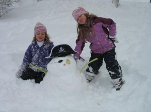 Girls building a snowman